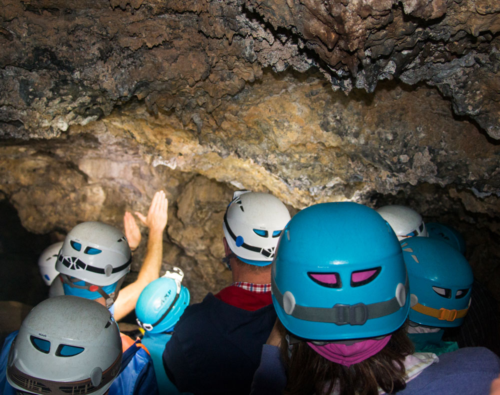 Visitors listen to the guide