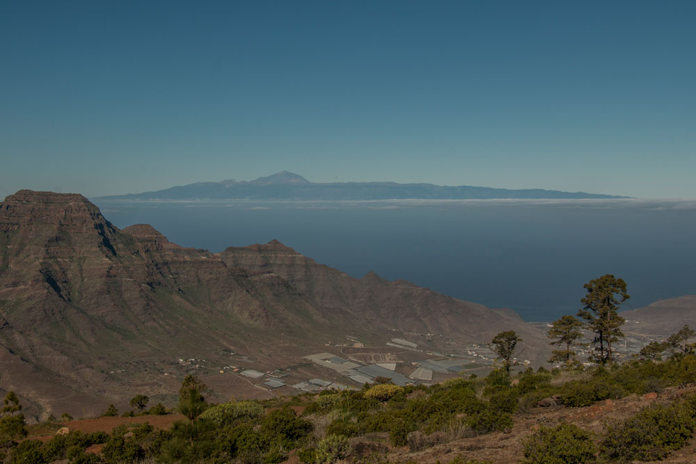 view from the hight to the valley of Aldea - in the background Tenerife and Teide