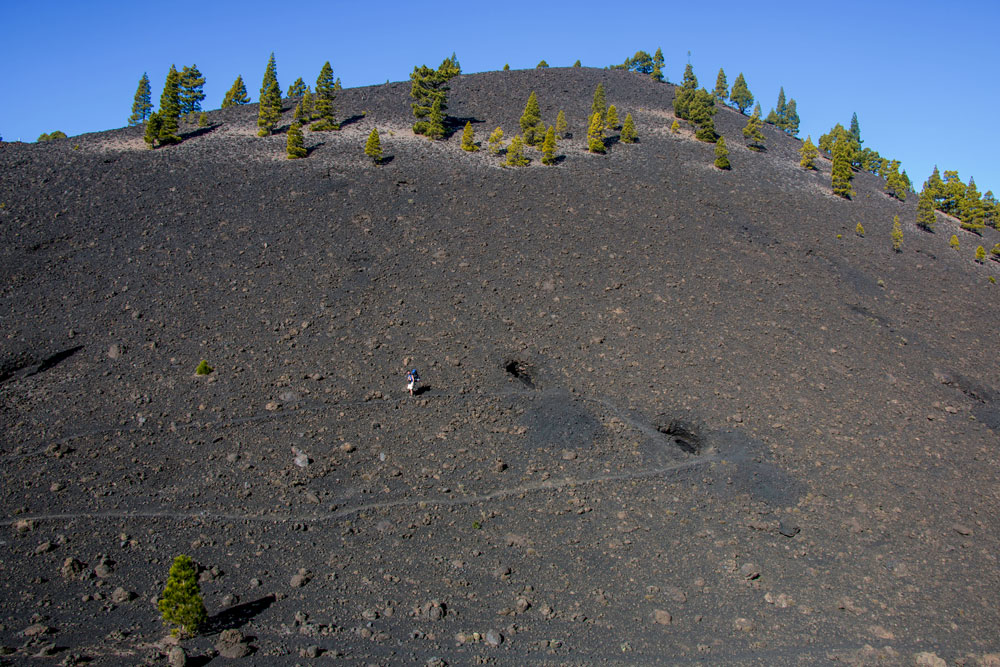 on the mighty volcanic slopes man seems small