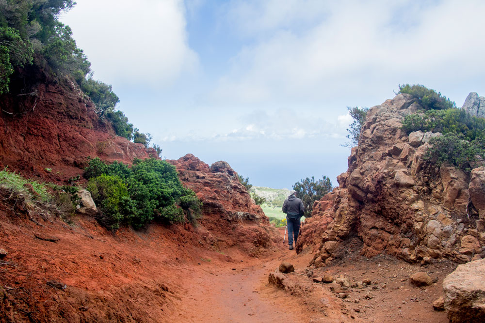 hiking through a red eroded rocky landscape
