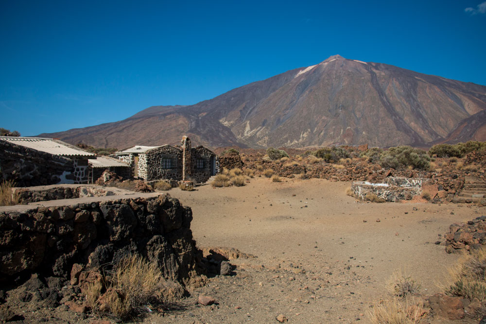 Old houses in front of Teide at the hiking path S 16