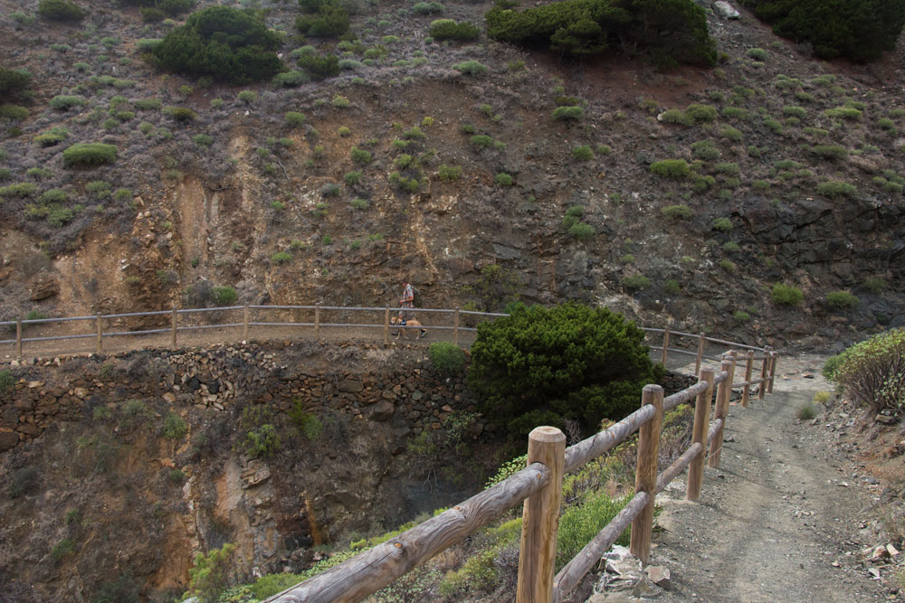 Hiking path from the steep cliffs down to the road in the gorge of Tamargada
