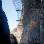 The steel net above the street protects against falling rocks and stones