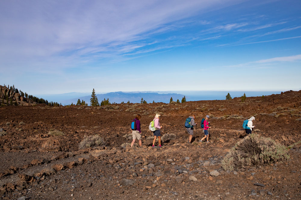 Hikers on footpaths - background La Gomera and El Hierro