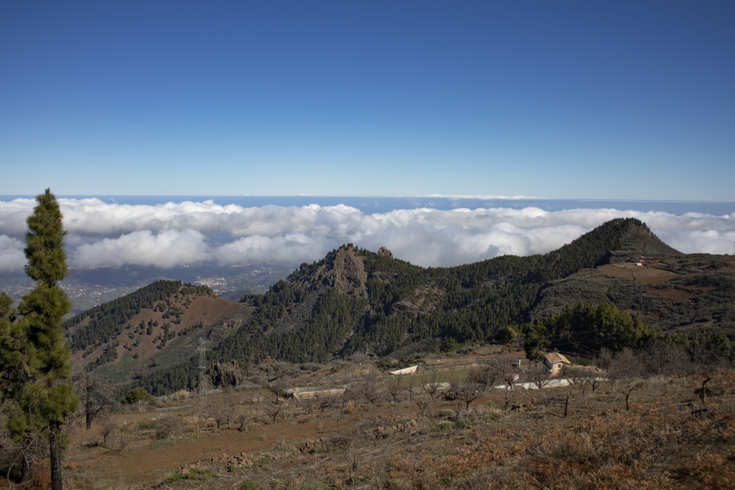 View over the mountain ranges and the clouds from the Becerra hiking trail