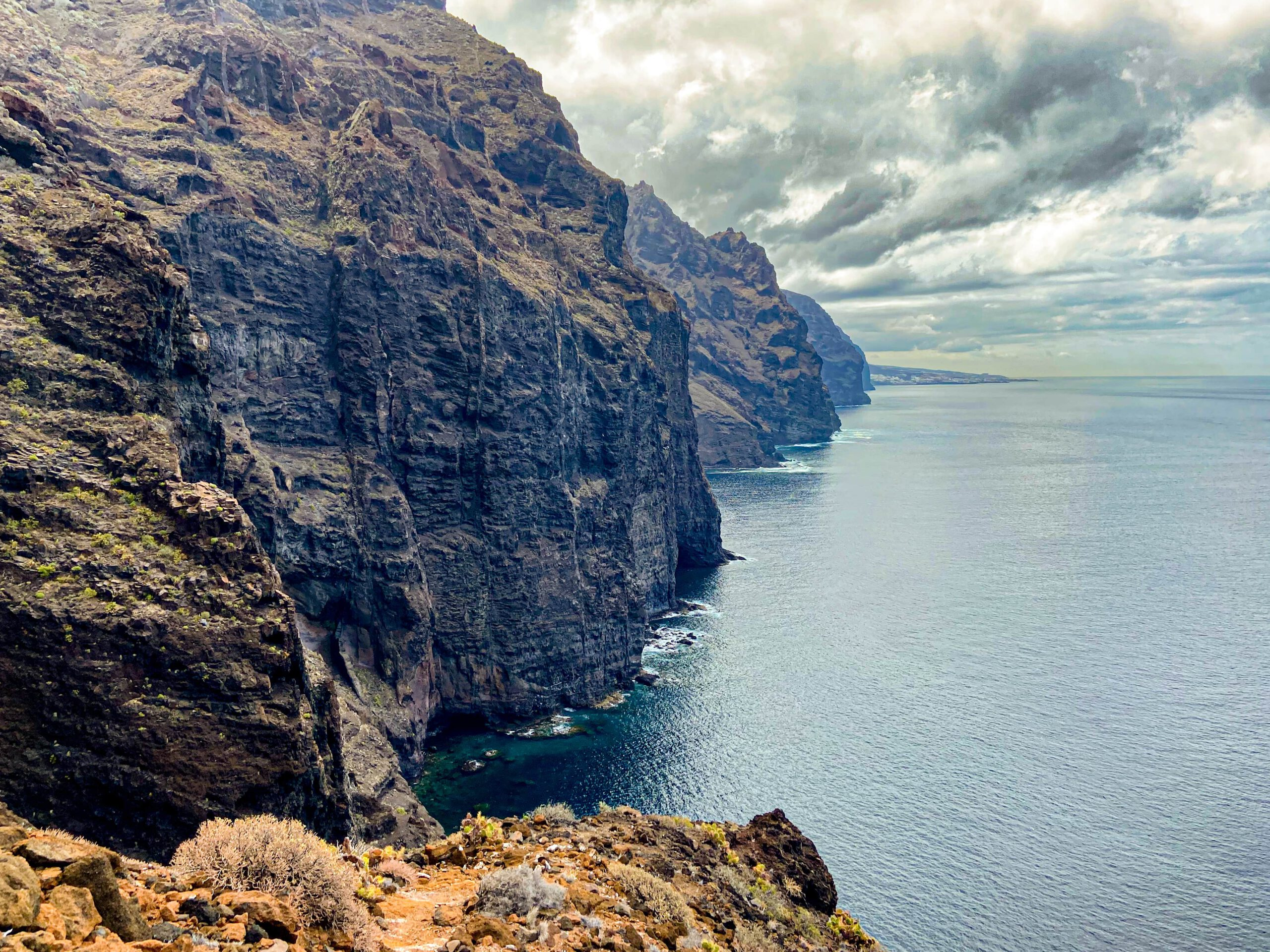 View from the hiking trail to the cliffs and Los Gigantes in the background