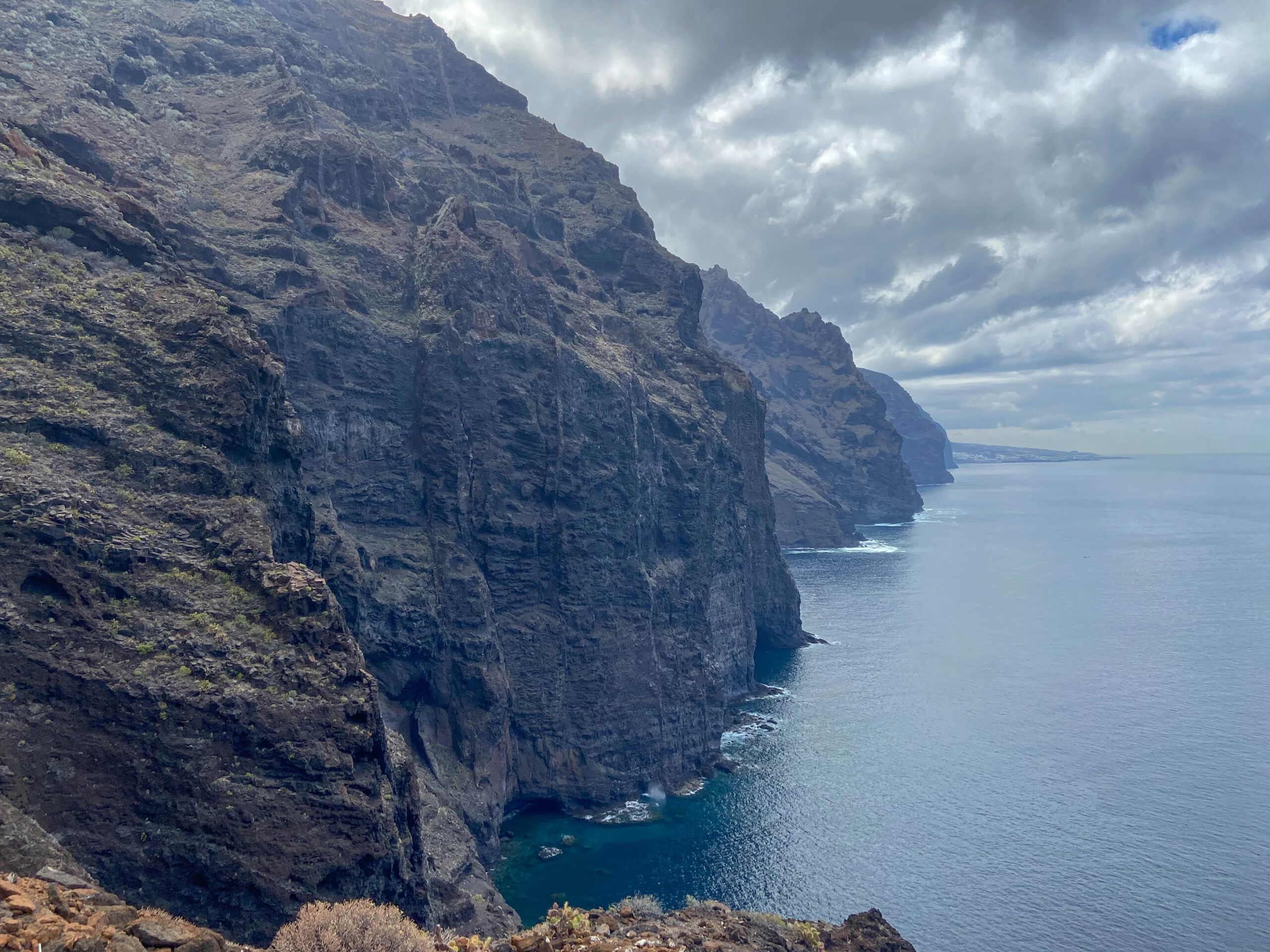 View of the cliffs and Los Gigantes in the background from the path on the cliff edge